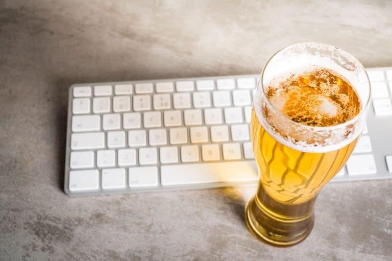 A beer and Mac keyboard