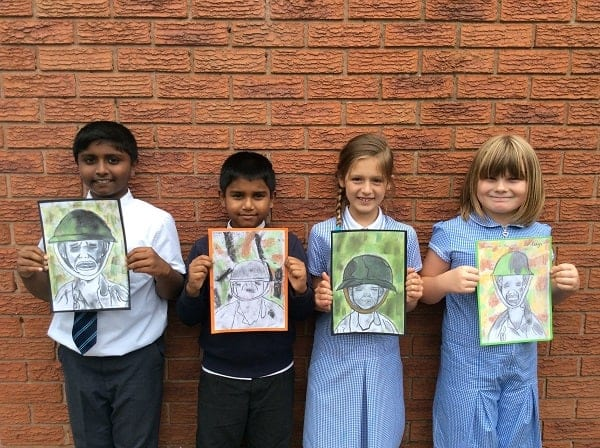 Children holding drawings