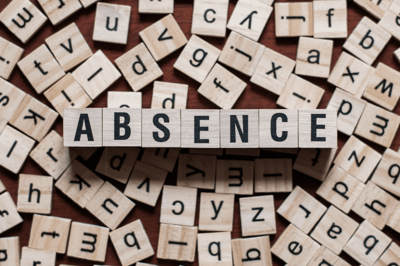Wooden blocks spelling the word 'Absence'