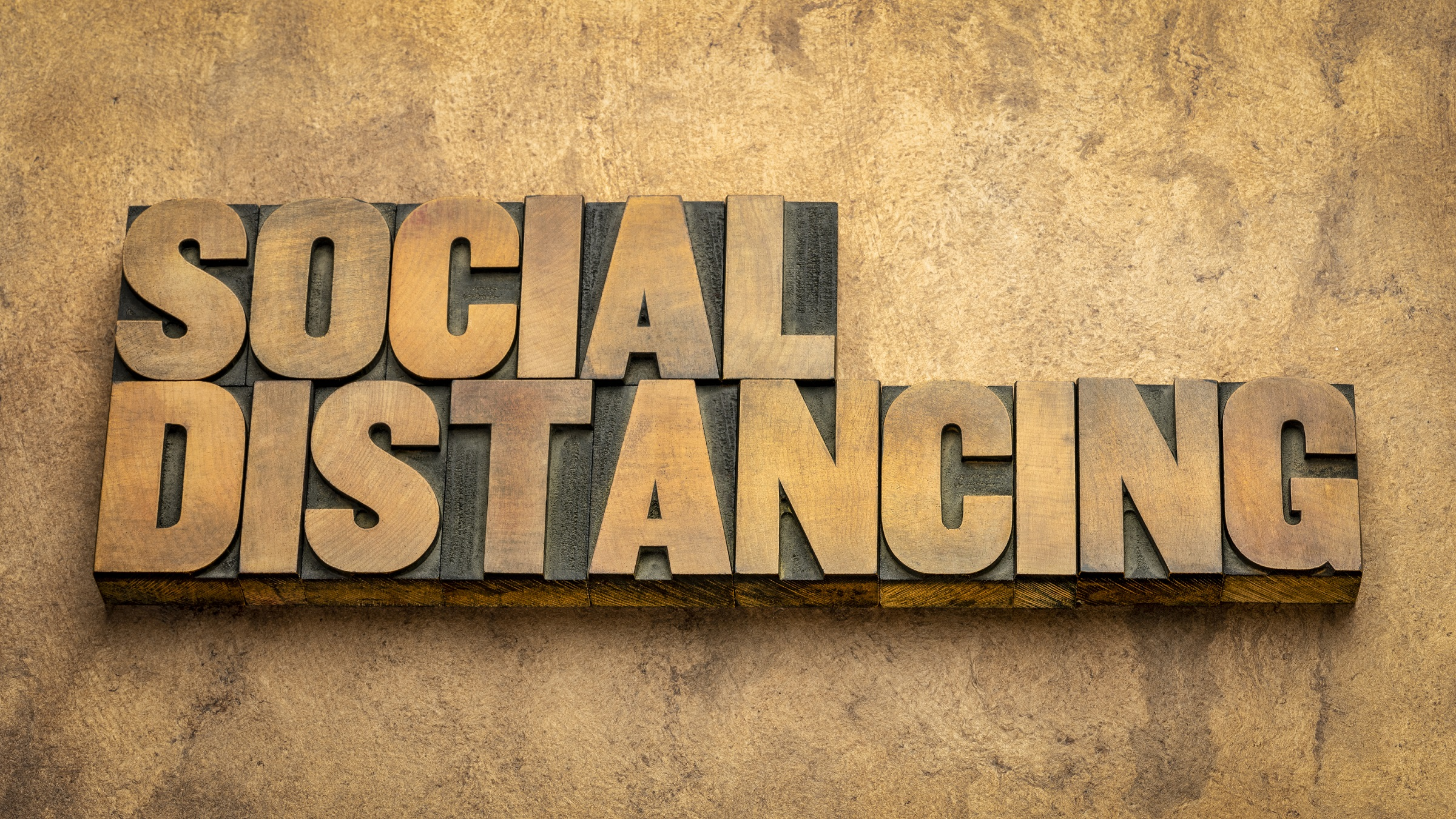 A sign saying 'social distancing'